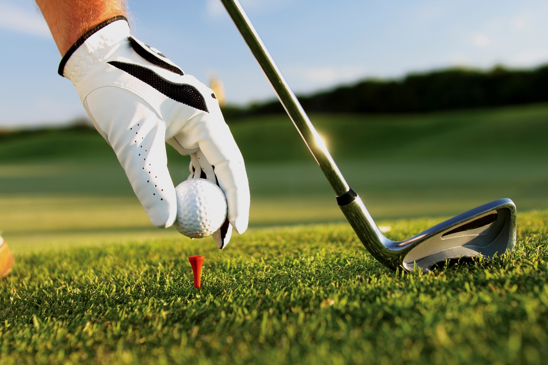 Golfer places golf ball on tee practicing for the Third Annual Community Foundation of Upper St. Clair Charity Golf Invitational that will be held on September 24, 2018, Golf Sponsors and Foursomes Wanted!